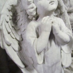 Cherub standing with folded hands